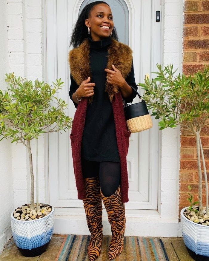 Mejacal wears a long vest over her turtleneck | 40plusstyle.com