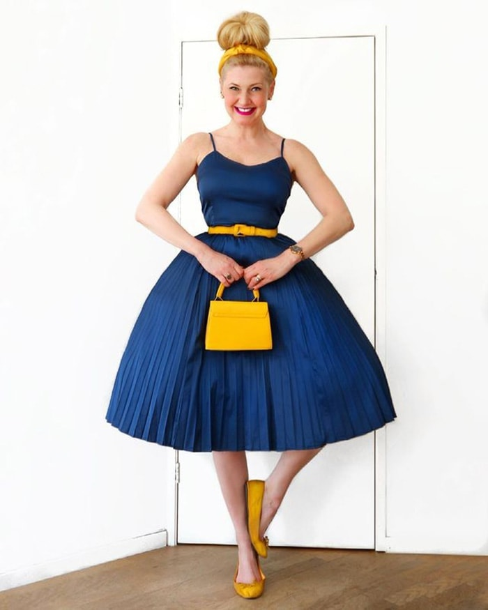 Carin in a yellow headband and blue dress | 40plusstyle.com
