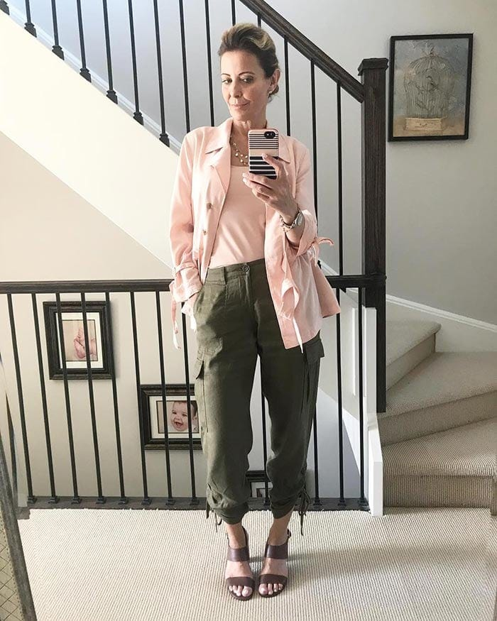 Susan wears cargo pants with a pink blazer | 40plusstyle.com