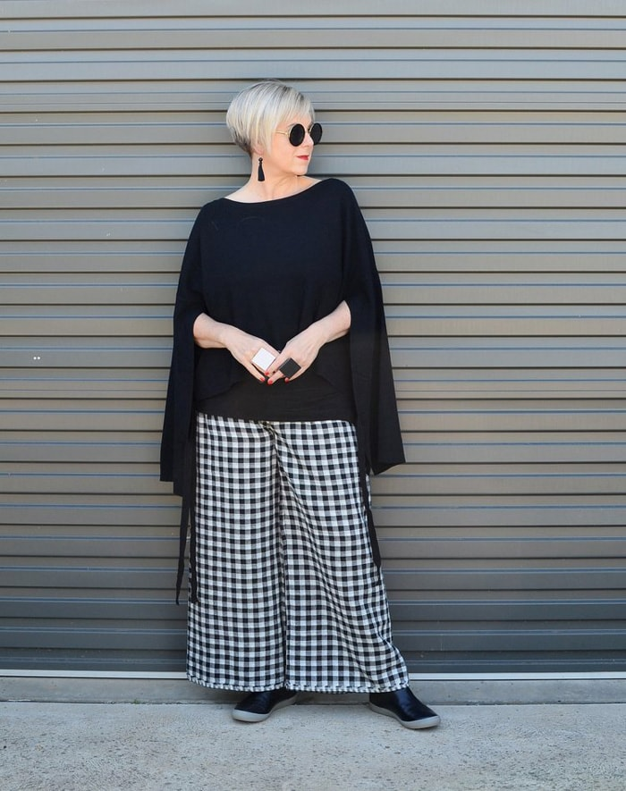 Deborah wearing black top and checkered pants | 40plusstyle.com