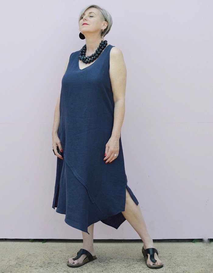 Deborah wears a navy dress with black accessories | 40plusstyle.com