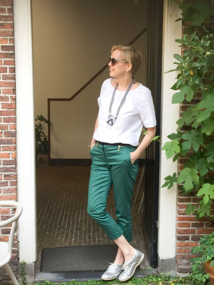 Printed green pants with white top and silver brogues | 40plusstyle.com