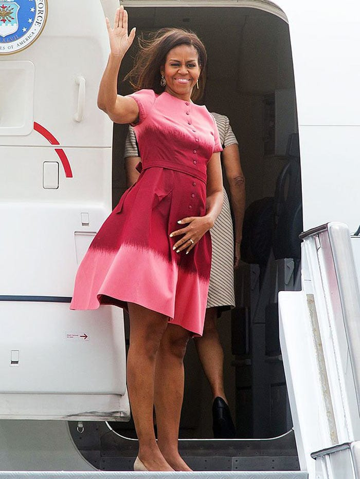 Michelle Obama wearing a bright pink dress | 40plusstyle.com