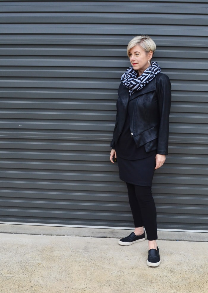 Deborah all black outfit with black and white scarf | 40plusstyle.com
