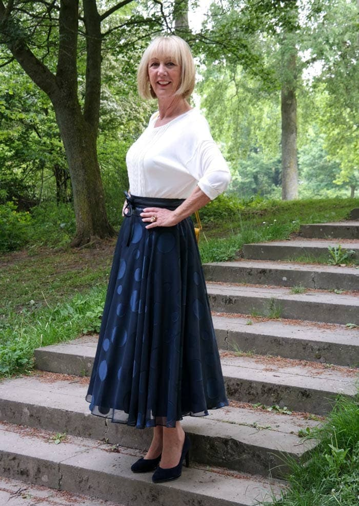 Greetje wears a navy and white outfit | 40plusstyle.com
