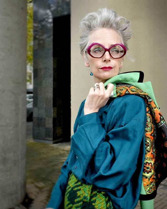 Melanie wearing a blue blouse and chic glasses   40plusstyle.com