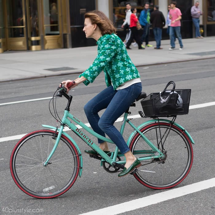 Getting noticed on a bike with a chic green jacket | 40plusstyle.com
