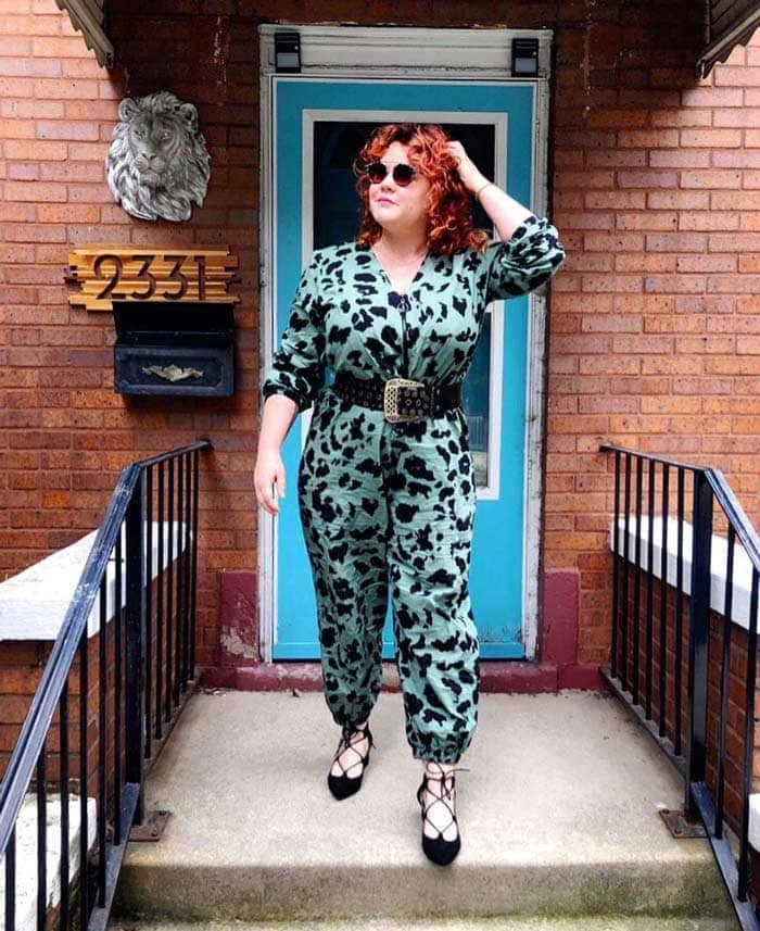 Joie wearing an animal printed jumpsuit and lace up flats | 40plusstyle.com