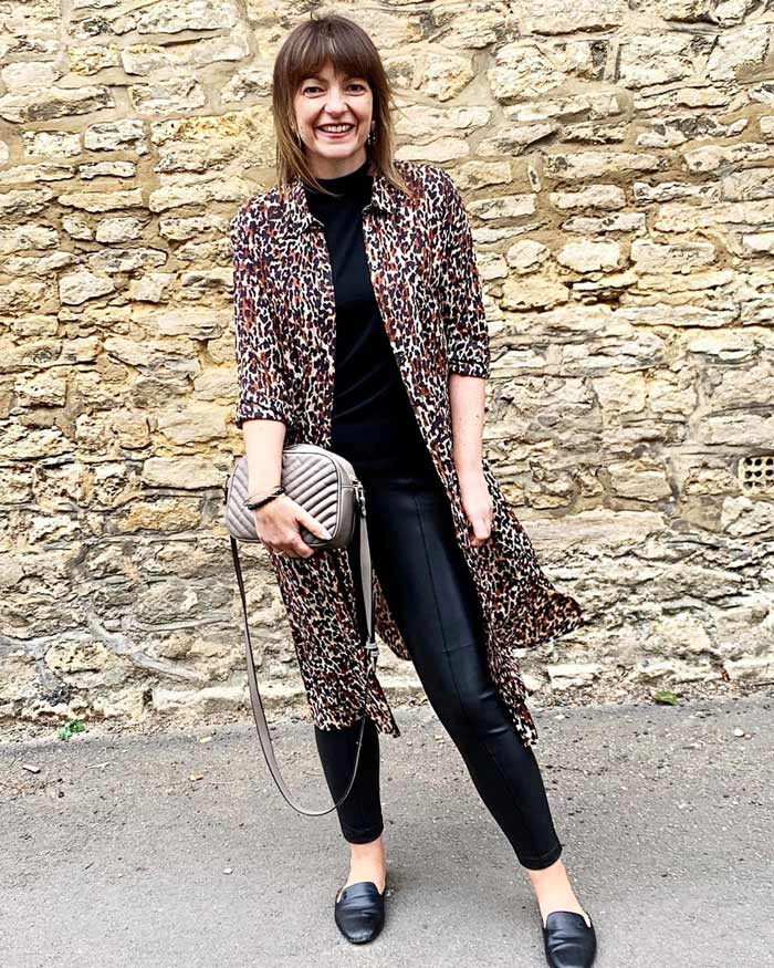 Lizzi wearing a leopard print topper with mock tee, leather leggings and loafers | 40plusstyle.com
