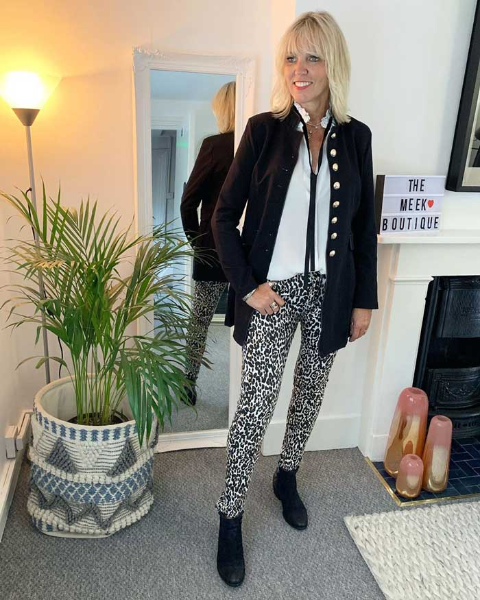 Lynne wearing a jacket with white blouse, calf print pants and booties | 40plusstyle.com