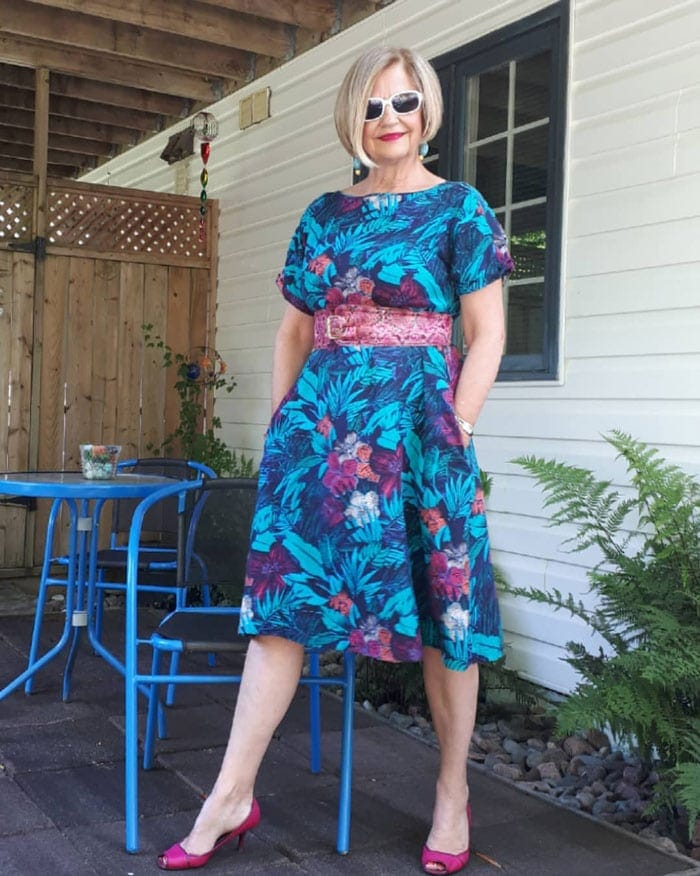 Terri wearing a printed dress with belt | 40plusstyle.com