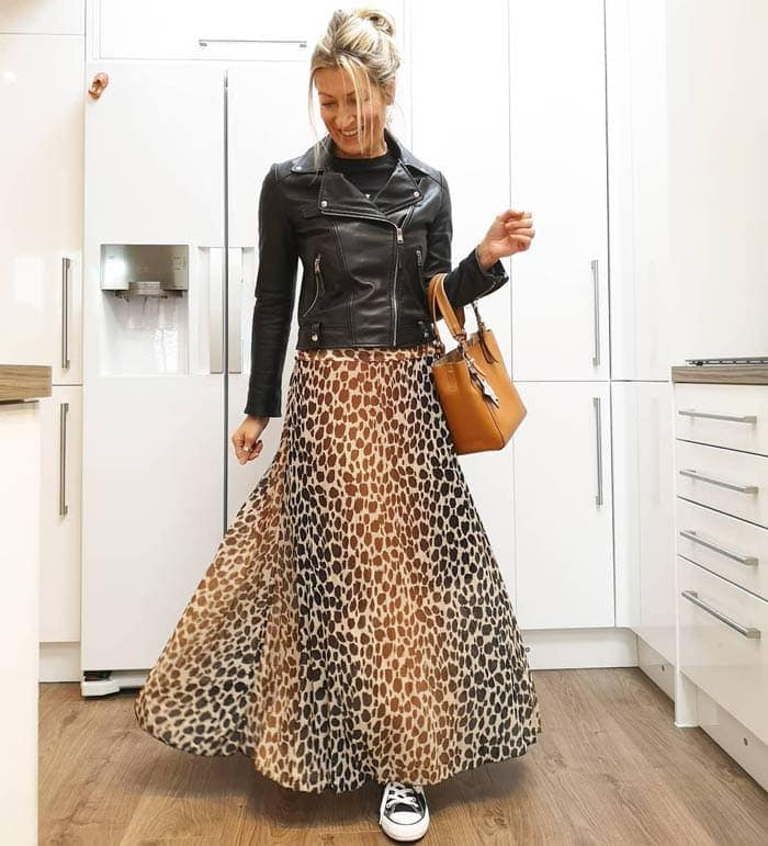 Abi wearing a moto jacket with a maxi leopard skirt | 40plusstyle.com