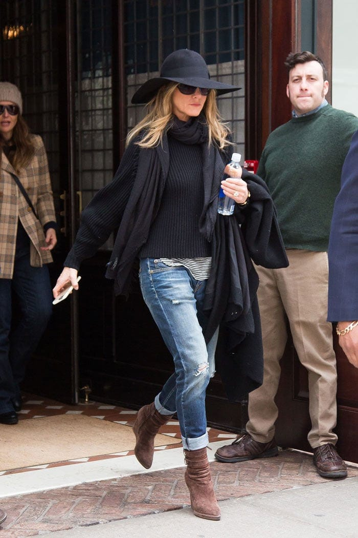 Jennifer Aniston fall look - sweater, floppy har, scarf, ripped jeans and booties | 40plusstyle.com