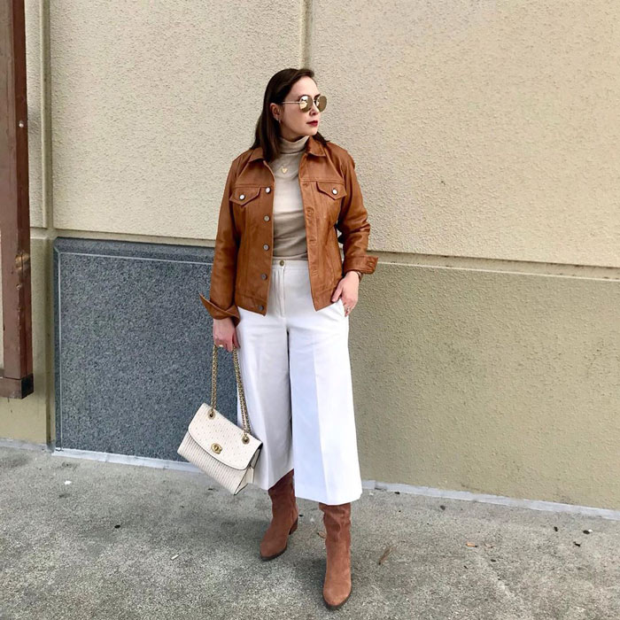 leather jacket worn with turtleneck top, wide leg jeans and boots   40plusstyle.com   40plusstyle.com