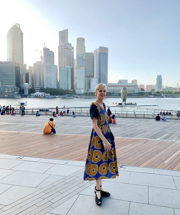 Wearing a sunflower dress at Marina Bay Singapore - ready for my best year ever!