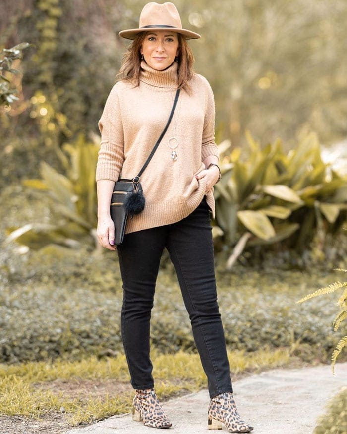 black skinny jeans paired with animal print and neutrals | 40plusstyle.com