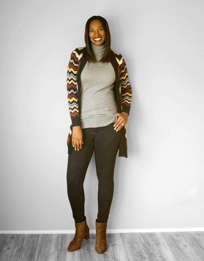 Tanasha wearing a longline cardigan, sweater, jeans and boots  | 40plusstyle.com