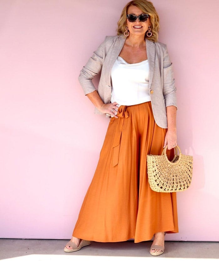 wear an orange skirt with a beige jacket | 40plusstyle.com