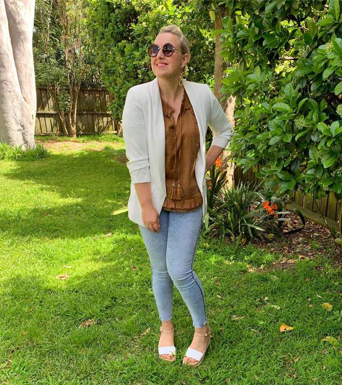 An outfit featuring jeggings and a white blazer | 40plusstyle.com