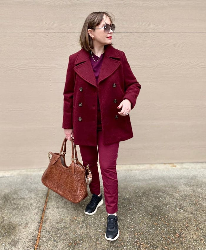 how to wear sneakers - wearing burgundy with black sneakers | 40plusstyle.com