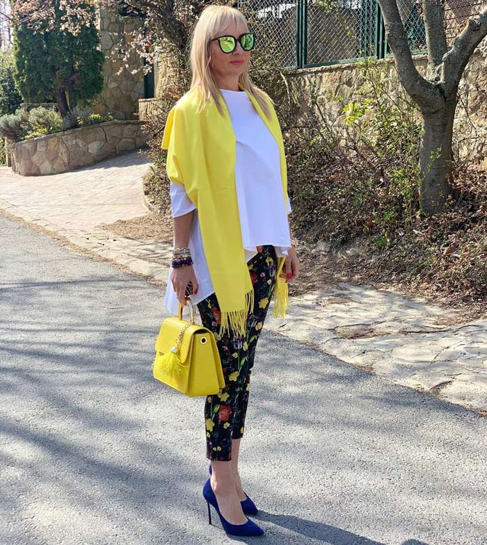 Yellow accessories goes well with black and white outfits | 40plusstyle.com