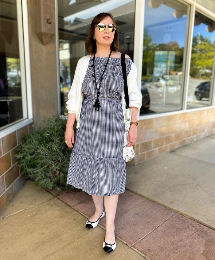wearing a midi dress with a cardigan | 40plusstyle.com