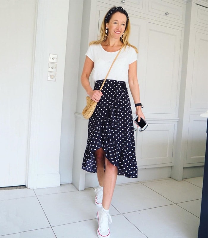 polka dot skirt and sneakers outfit | 40plusstyle.com