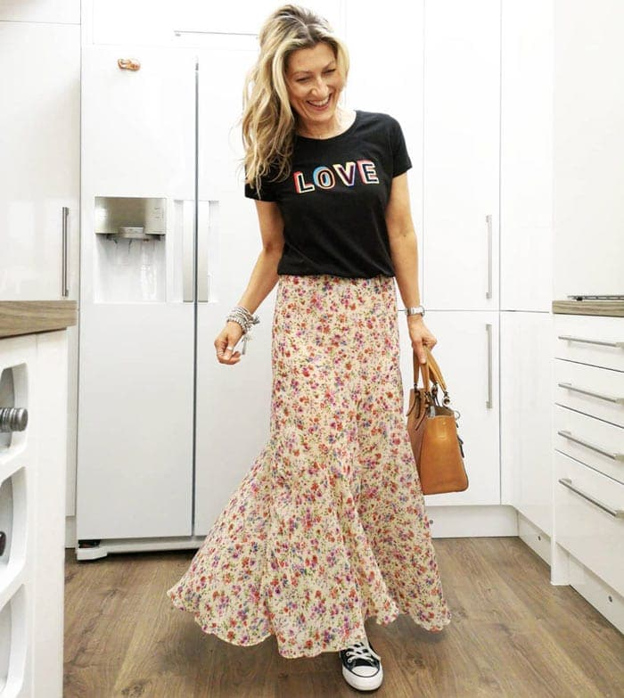 wearing a maxi skirt with a slogan t-shirt | 40plusstyle.com