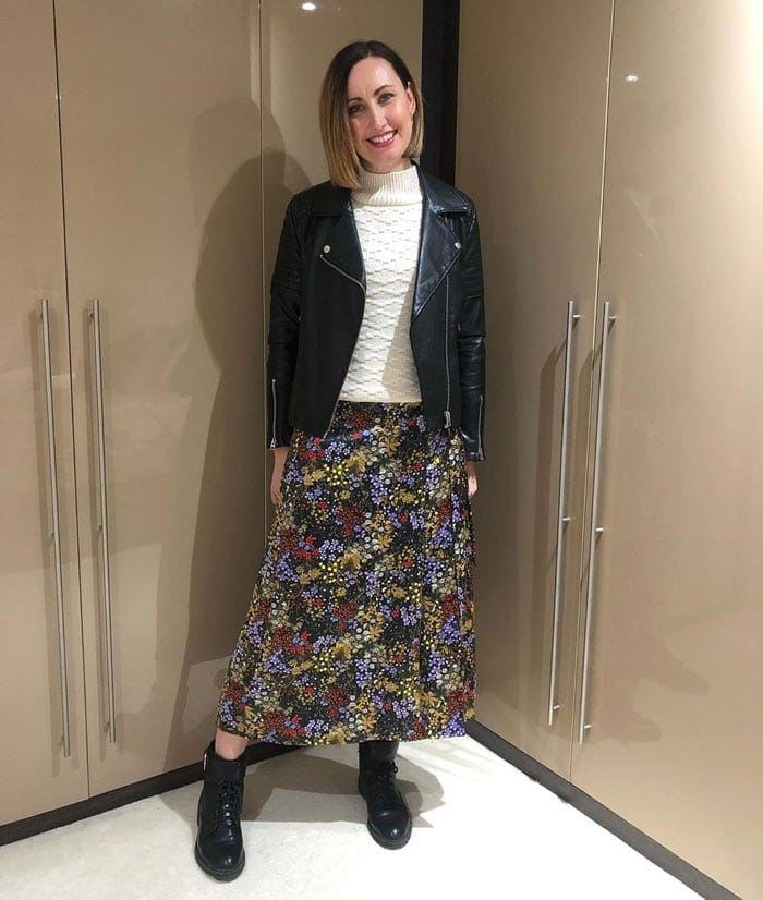 Lou wearing biker boots and a floral skirt | 40plusstyle.com