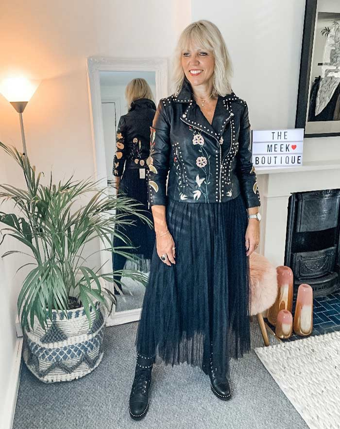 Lynne wearing a rock style moto jacket and black skirt | 40plusstyle.com