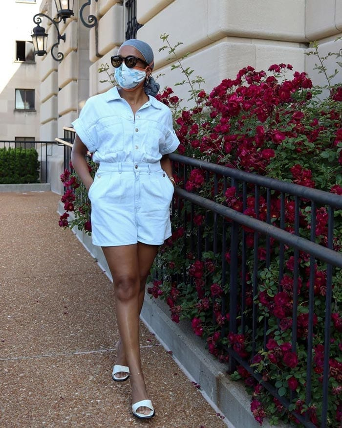Psyche wears flat mules with her romper suit | 40plusstyle.com