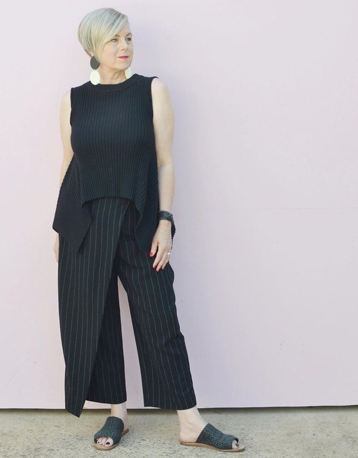 Deborah wearing an asymmetrical top and pants | 40plusstyle.com