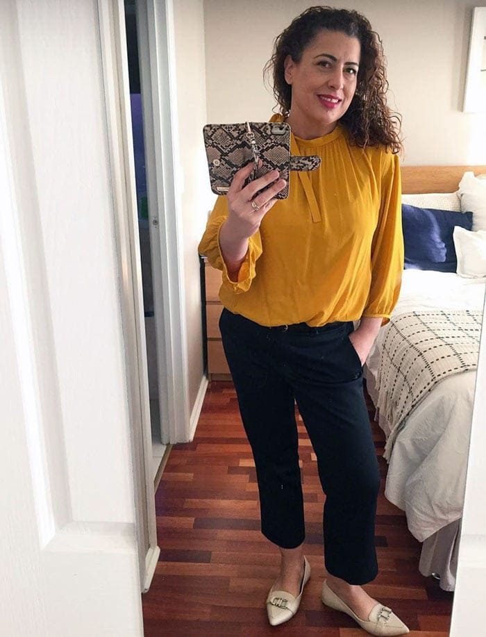 Fee wears smart loafers, pants and a yellow blouse | 40plusstyle.com