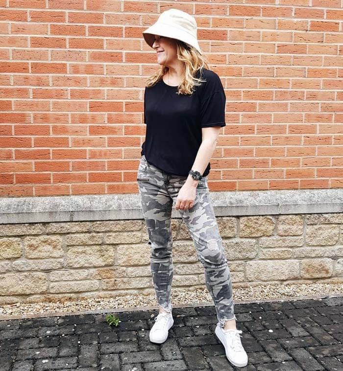 travel clothes for women - Gail wearing utility cargo pants and a black t-shirt | 40plusstyle.com