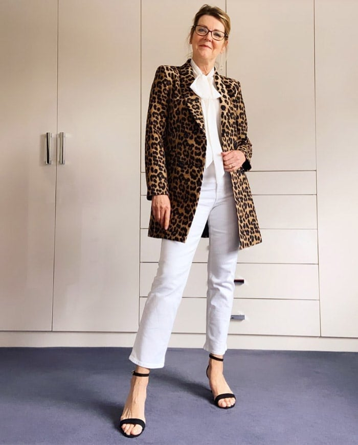 Helen wears white jeans with a leopard print coat | 40plusstyle.com