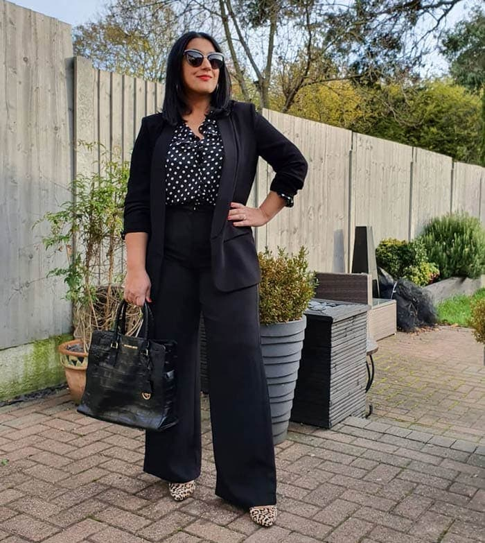 What to wear to a conference: Jas wears a black pant suit | 40plusstyle.com