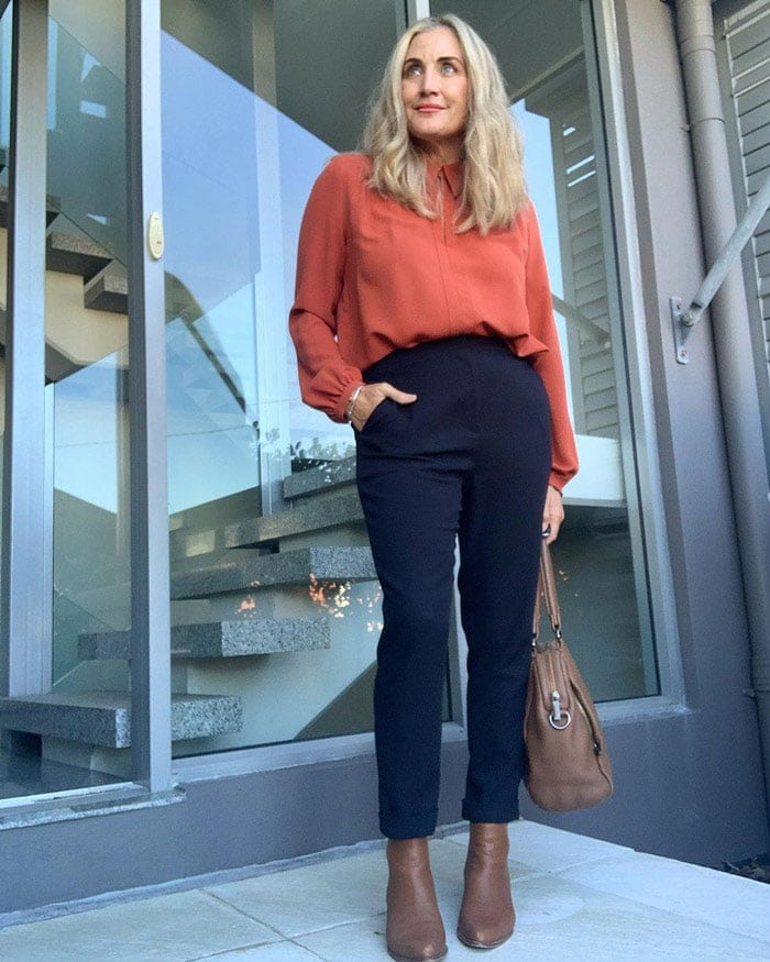 Wearing booties for work - Melinda teams her booties with navy pants | 40plusstyle.com