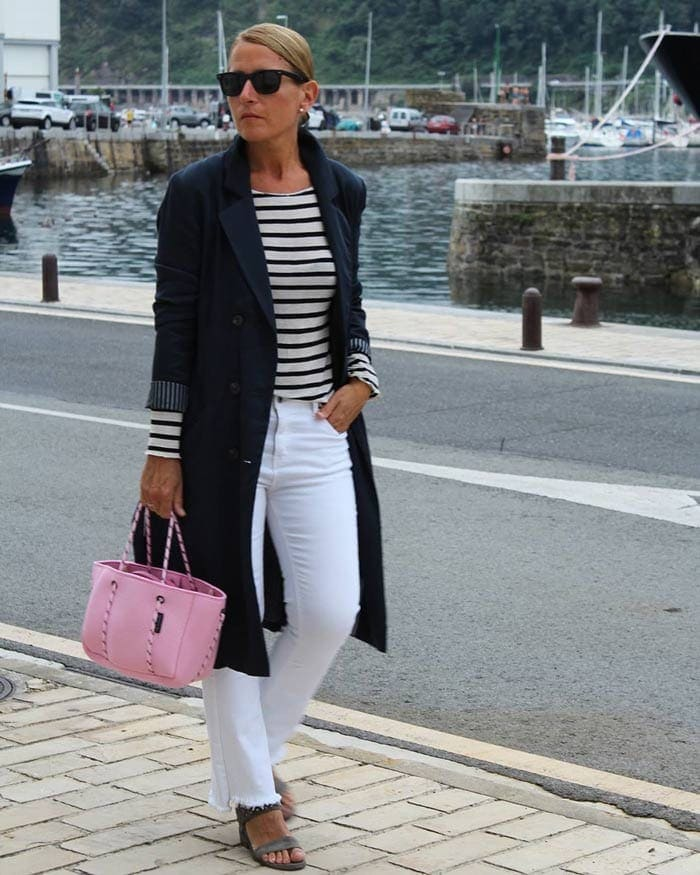 Nagore wearing a nautical-inspired outfit with her raw hem pants | 40plusstyle.com