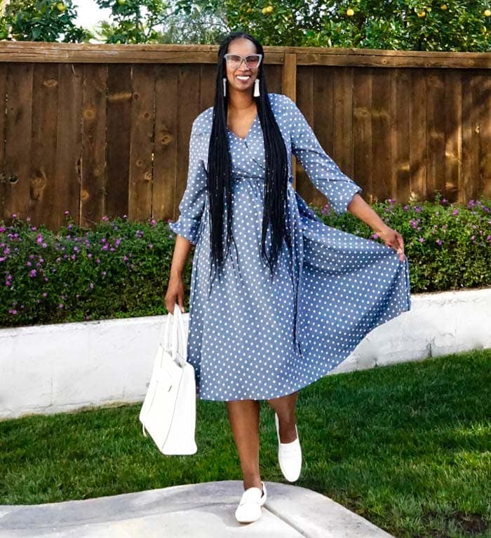 Tanasha wearing white loafers with a summer dress | 40plusstyle.com