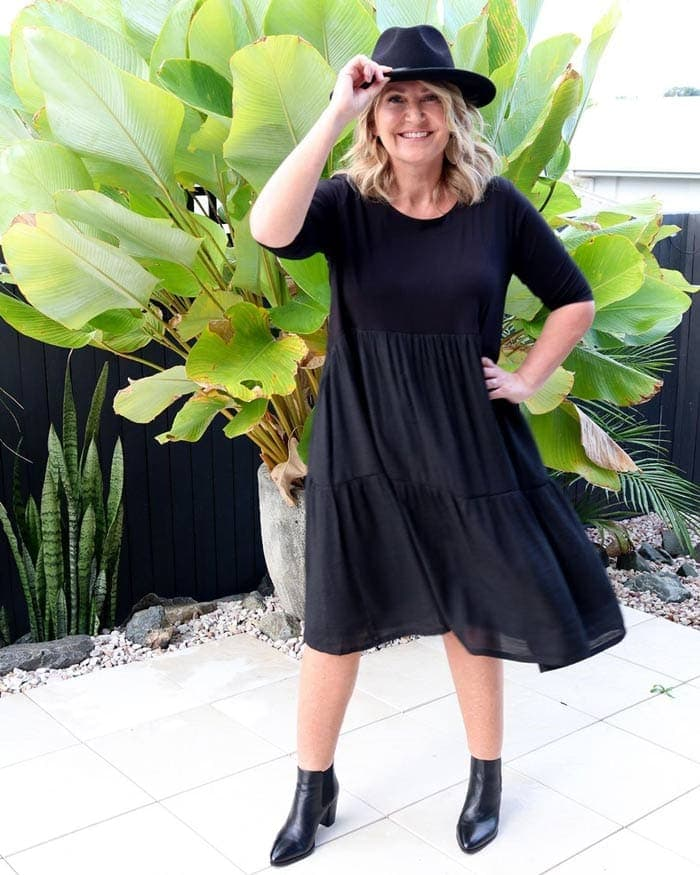 Bev wearing a tiered dress with booties | 40plusstyle.com