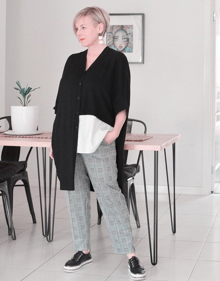 Deborah wearing an asymmetrical top and plaid pants | 40plusstyle.com