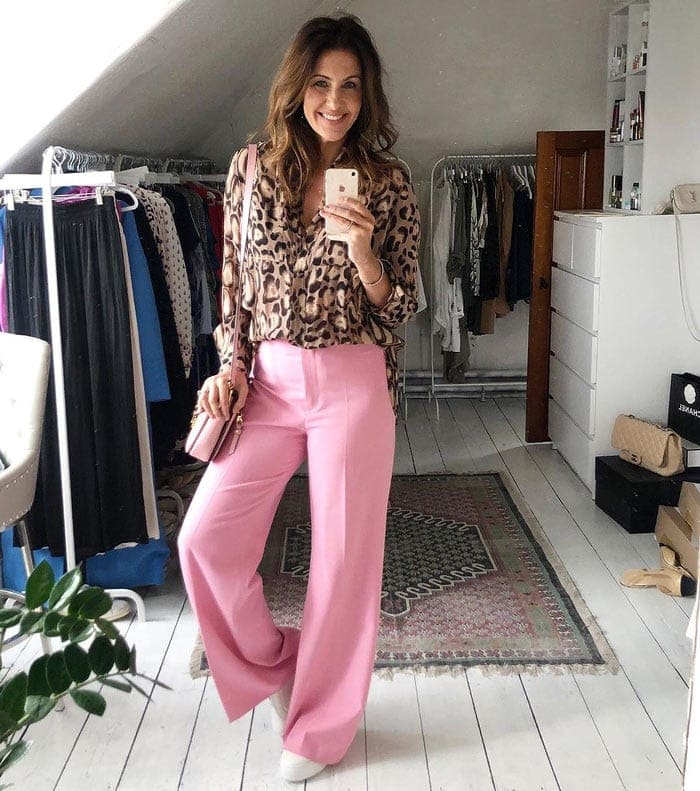 Wearing a printed blouse with a pair of wide legged pants   40plusstyle.com