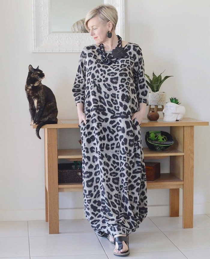 Deborah wears an animal print maxi dress | 40plusstyle.com