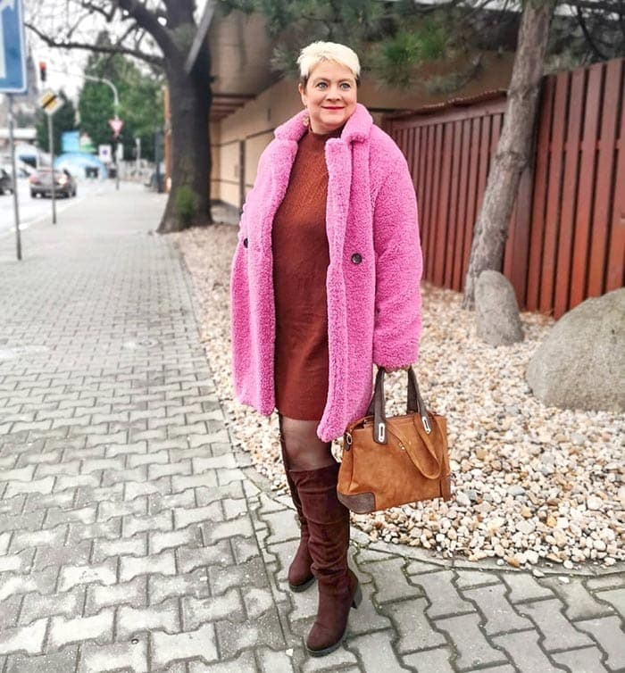 Lucie wears a red sweater dress and pink faux fur coat | 40plusstyle.com