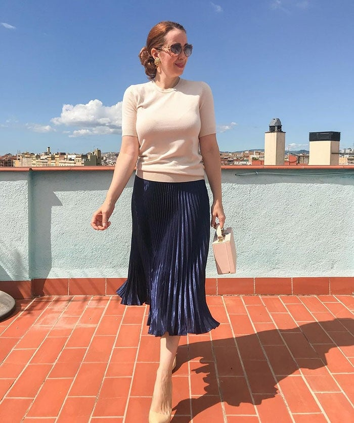 How to dress for Thanksgiving - Patricia wearing a pleated skirt and sweater | 40plusstyle.com