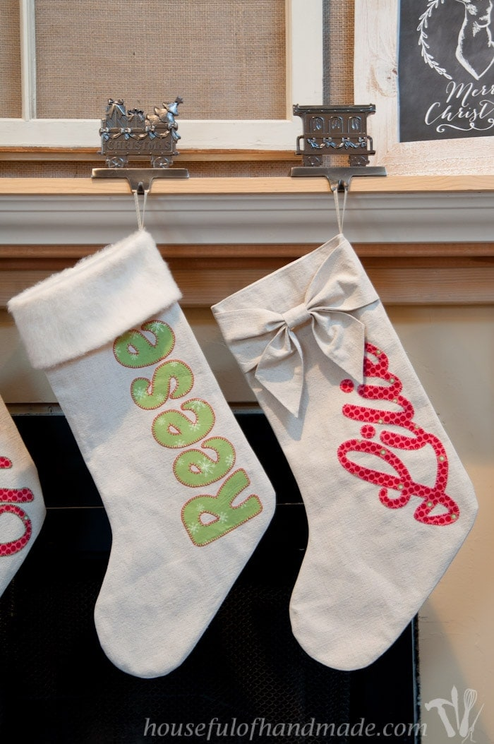 personalized drop cloth Christmas stockings hanging on fireplace mantel