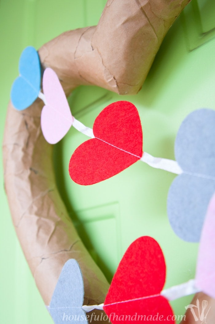 Make this fun rustic Valentine's Day wreath with only 3 items from the dollar store and a few free items! This $3 Rustic Valentine's Day heart wreath looks like it cost so much more! Includes lots more budget Valentine's Day crafts too. | Housefulofhandmade.com