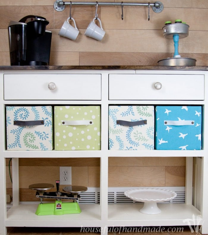 Coffee bar station shown with diy fabric storage boxes.