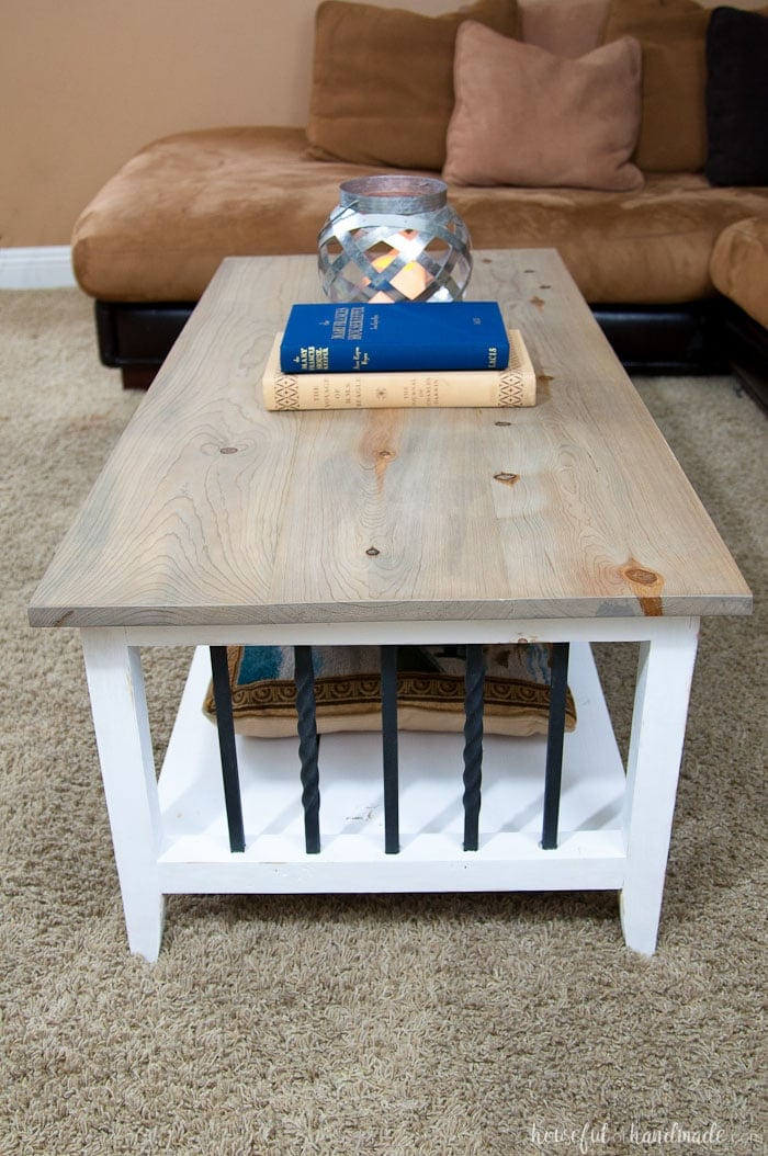 Farmhouse coffee table with iron accents and a weathered gray natural stain on the top.