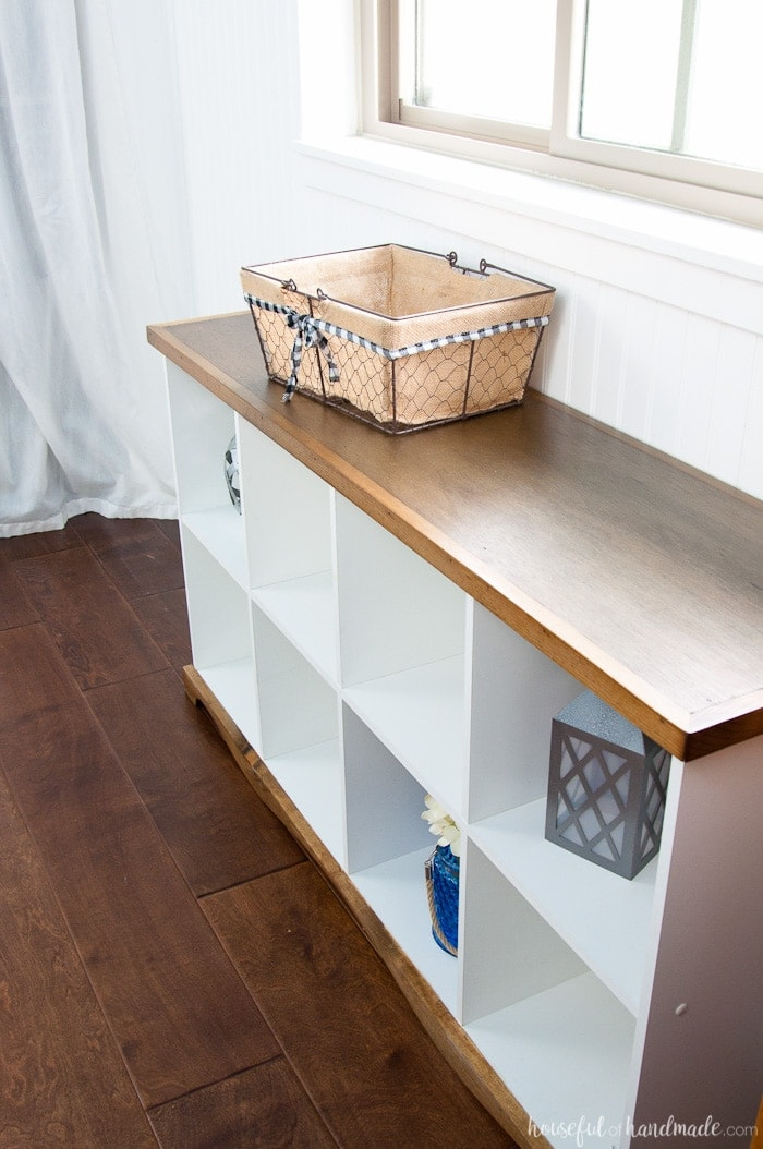 Use these amazing DIYs to Organize your home this year. Don't throw out those old melamine bookcases. Create a beautiful farmhouse console table DIY from an upcycled cube bookcase. An easy and inexpensive DIY. Housefulofhandmade.com | Farmhouse Bookcase | Free Build Plans | DIY Console Table | Upcycled Bookcase | Cube Bookcase Storage | Budget Makeover | $100 Room Challenge